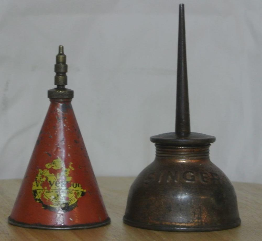 A collection of 2 antique oil cans