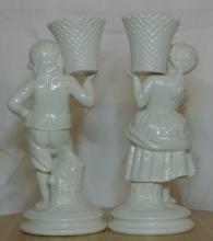 Lot 45: A pair of Belleek ceramic 'Basket Bearer' figures