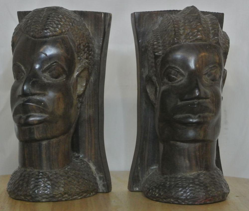 A pair of antique hand carved African busts
