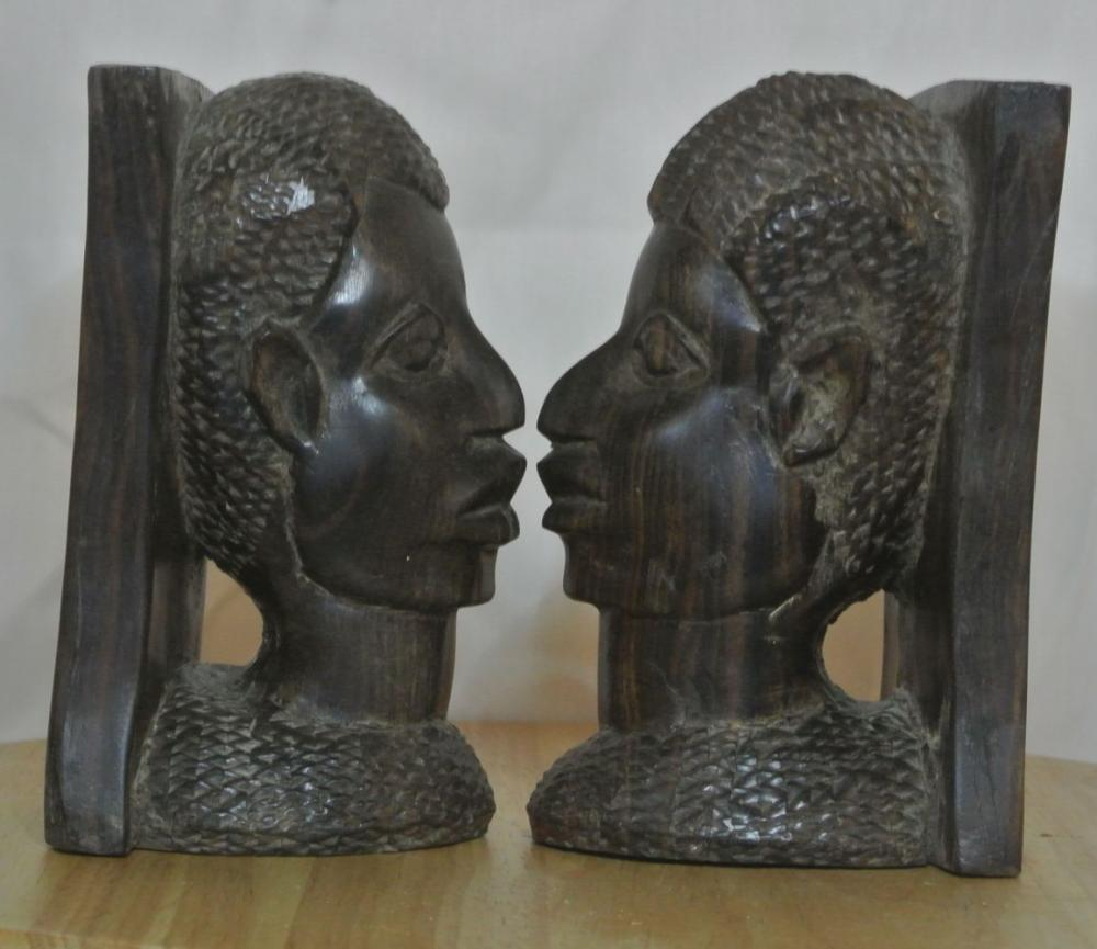 Lot 49: A pair of antique hand carved African busts
