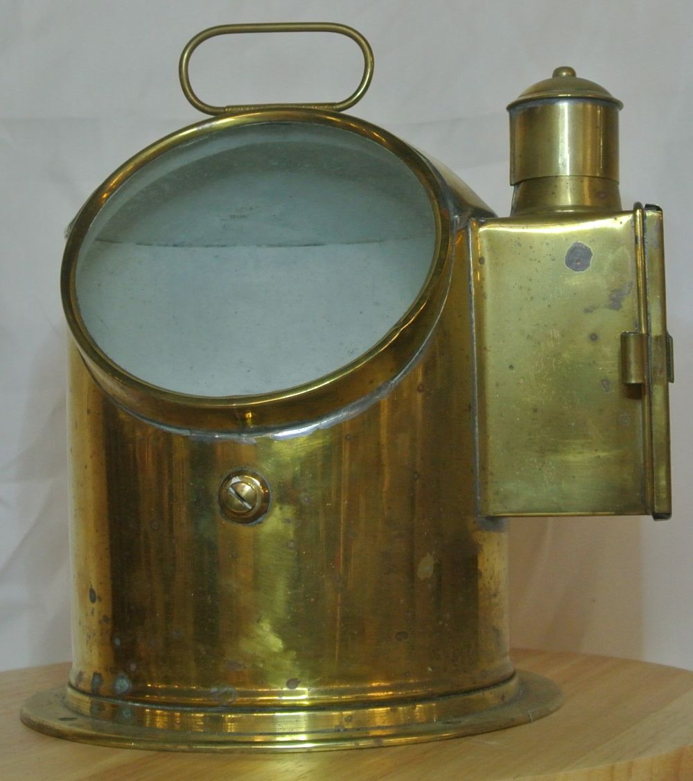 An antique brass cased ships binnacle floating compass