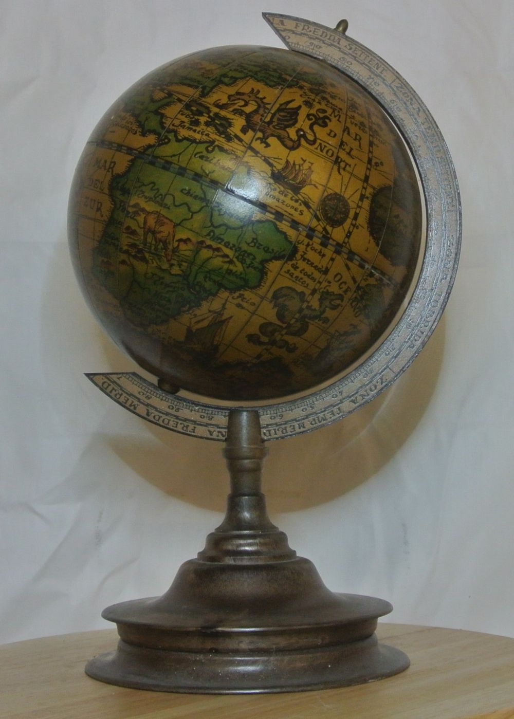 An antique style globe with bakelite base.