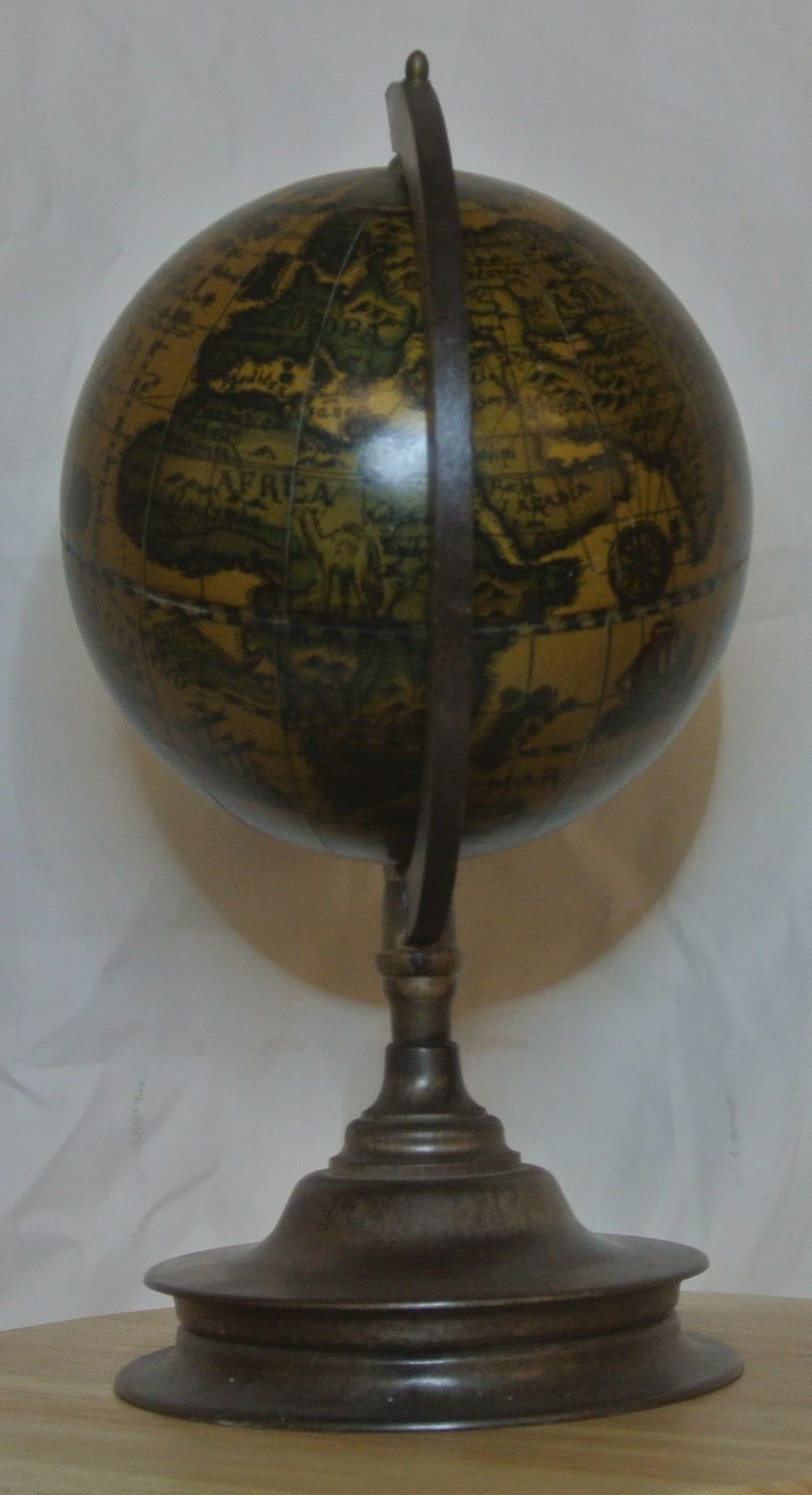 Lot 57: An antique style globe with bakelite base.