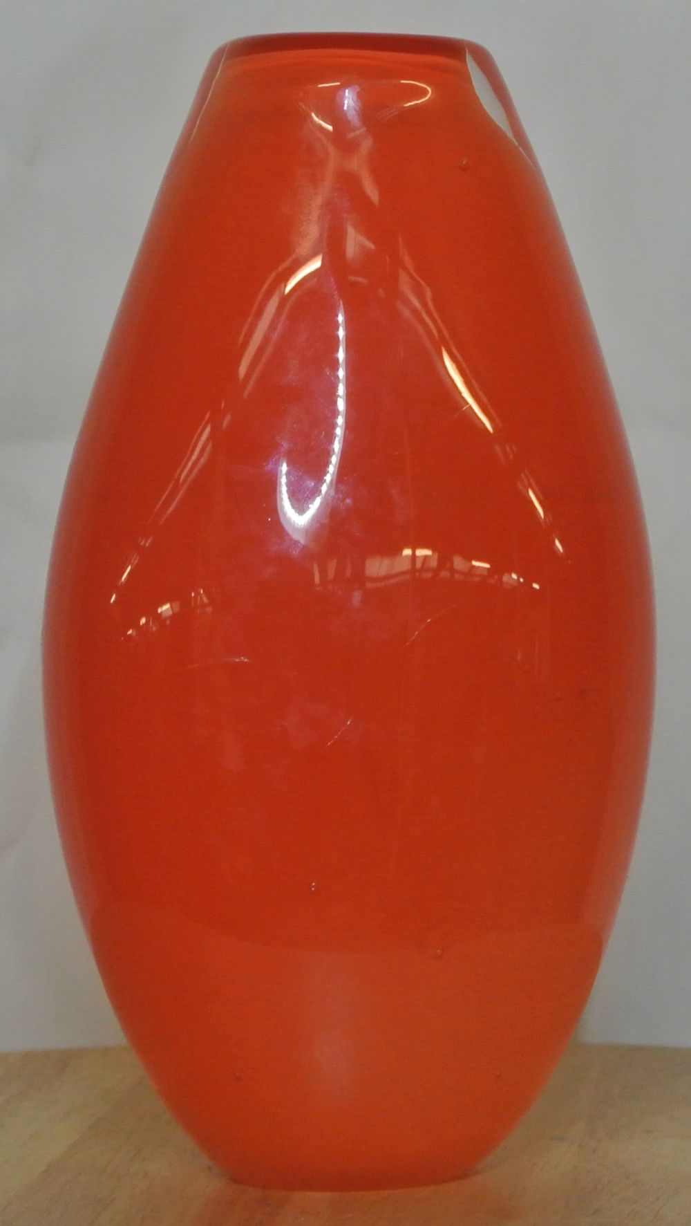 Lot 64: A decorative orange glass vase with applied painted design
