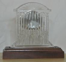 Lot 81: A Waterford Crystal quartz clock on wooden base.