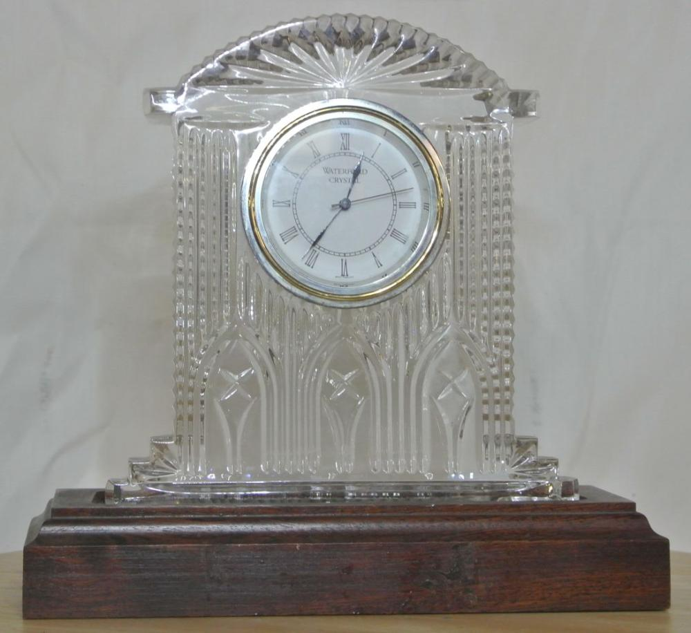 A Waterford Crystal quartz clock on wooden base.
