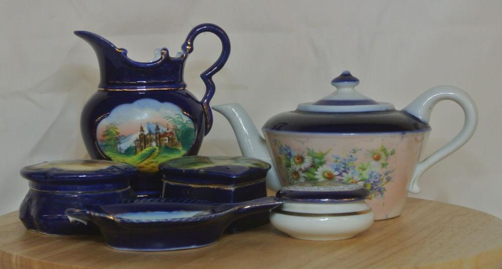 Lot 82: A collection of 6 antique pieces of souvenir ware items