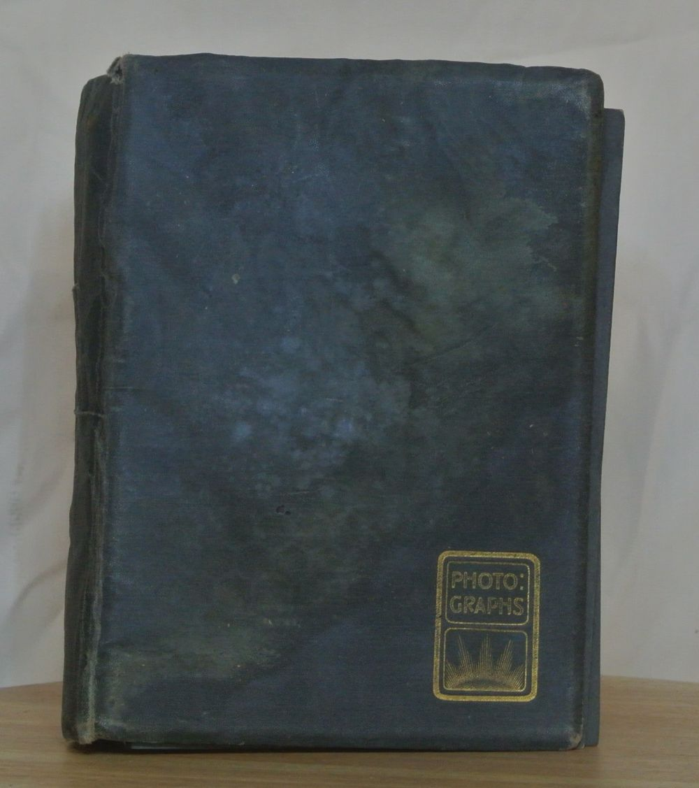 Lot 87: An antique photo album containing various snapshots.