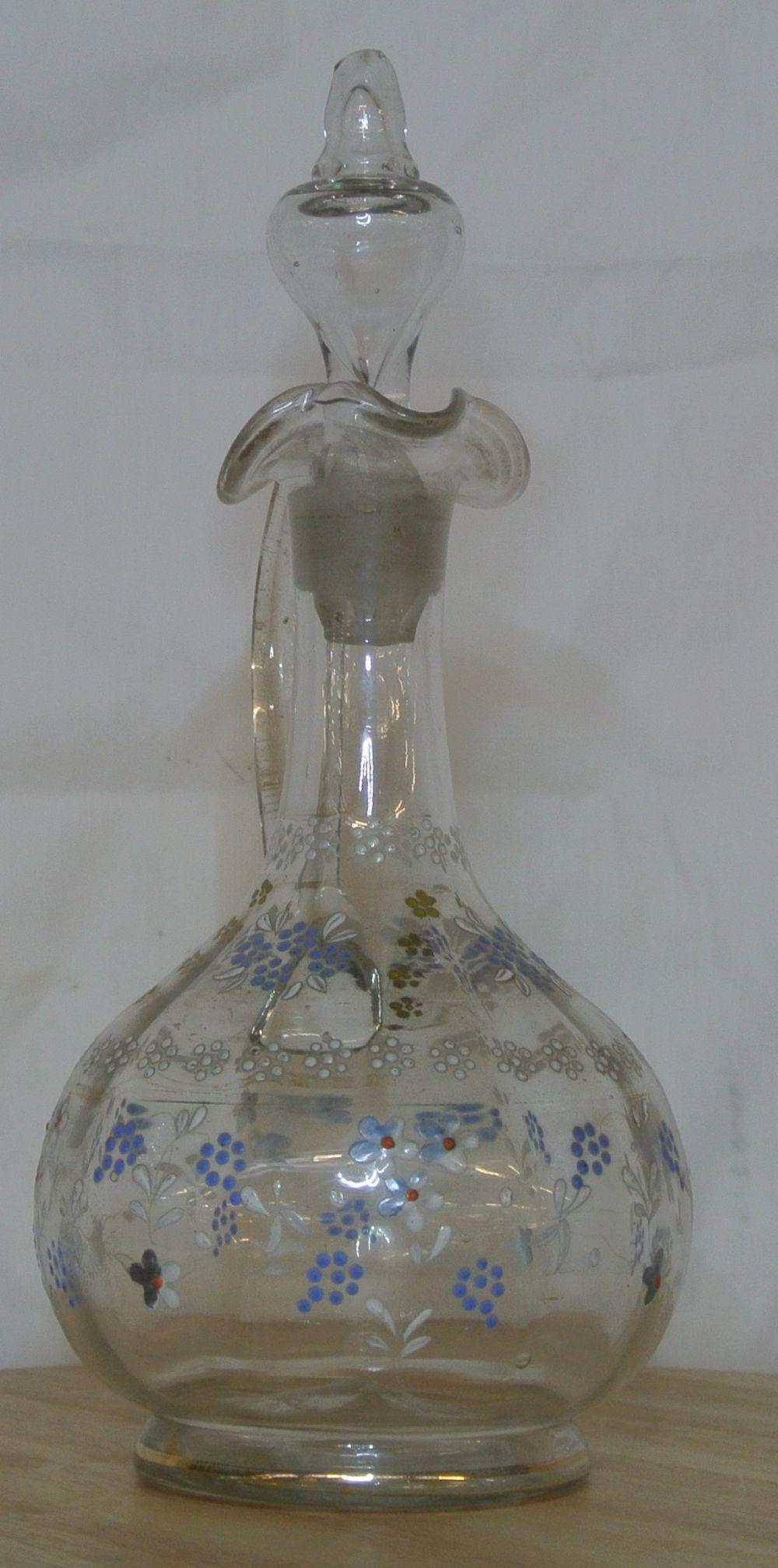 Lot 99: An antique hand painted glass claret jug