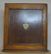 Lot 109: An antique oak smokers cabinet