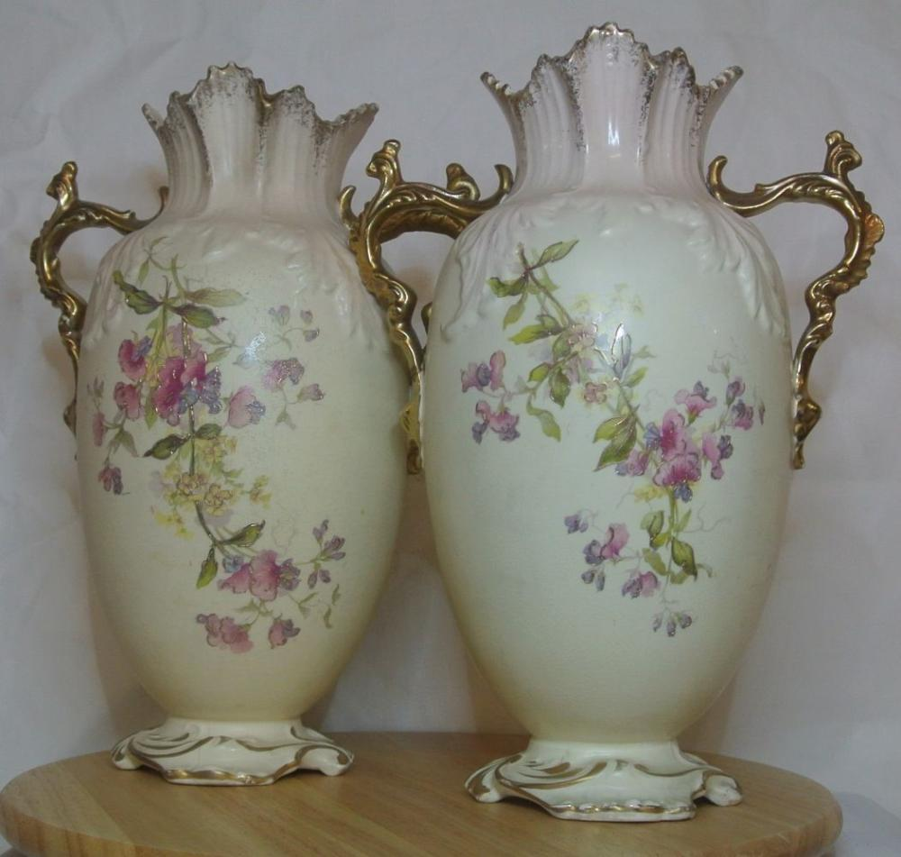 A stunning pair of Victorian hand painted floral vases