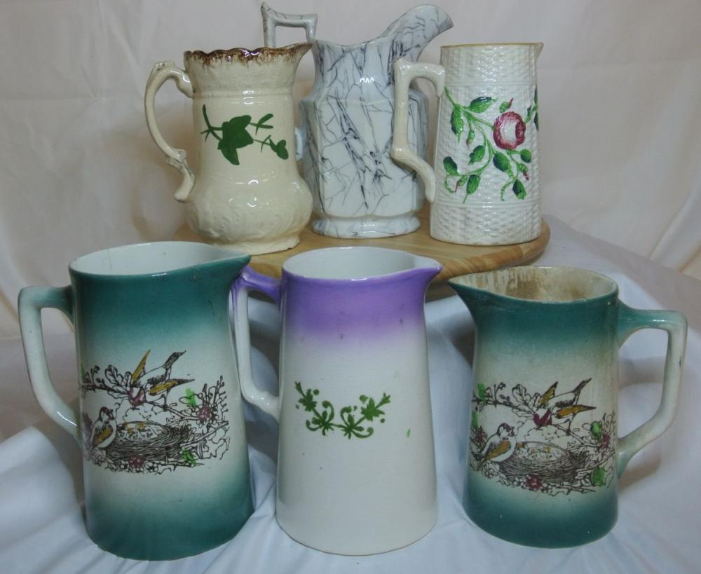 A collection of 6 antique ceramic jugs