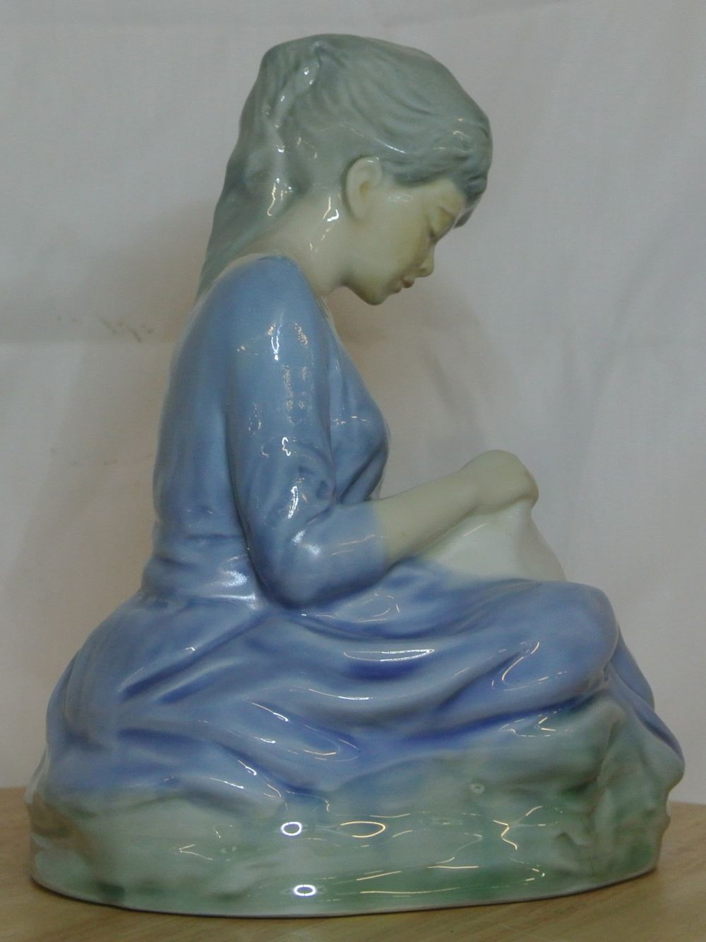 Lot 118: A rare Wade figure of a Lady sewing.