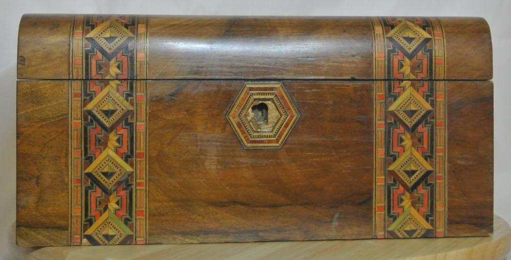 A stunning antique inlaid sewing box with mother of pearl cartouche.