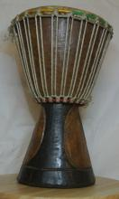 Lot 120: An African drum/ bongo.