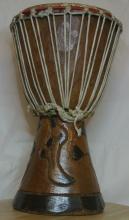 Lot 121: An African drum/ bongo.