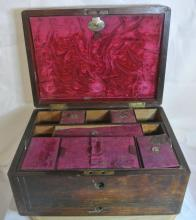 Lot 147: An antique dressing table/ sewing box