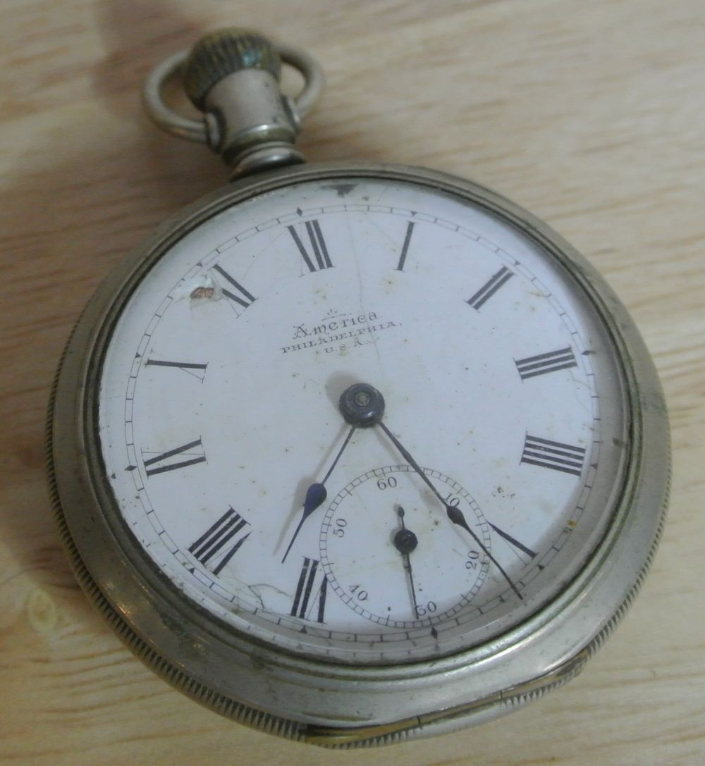 An antique silver plated cased pocket watch