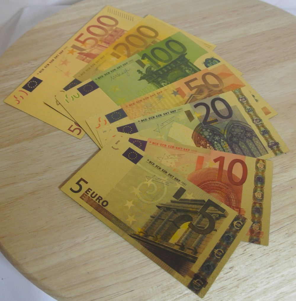 A collection of gold laminated Euro banknotes