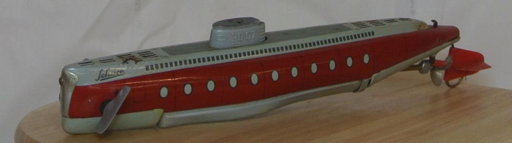 Lot 5: A vintage tinplate clockwork submarine, produced by Schuco.