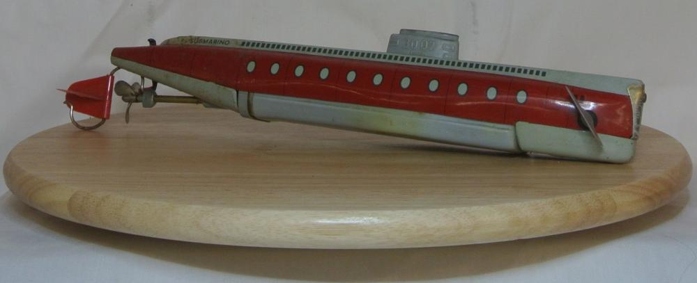 A vintage tinplate clockwork submarine, produced by Schuco.