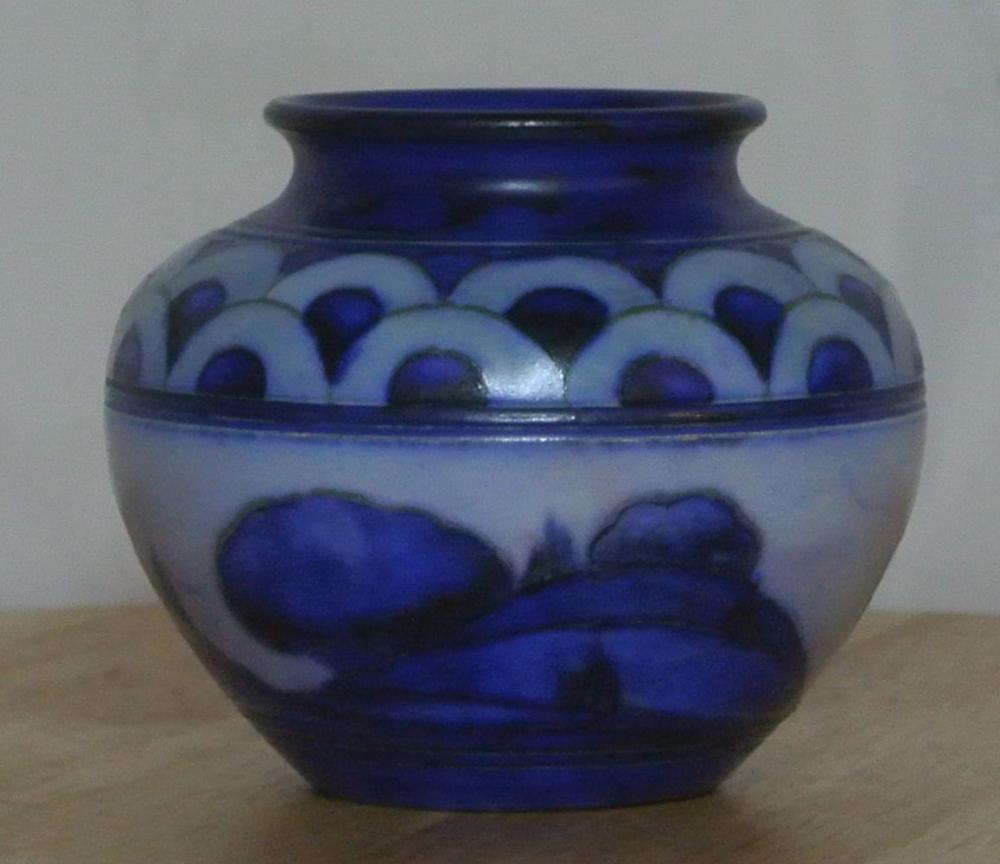 Lot 19: A small Moorcroft vase in various shades of blue