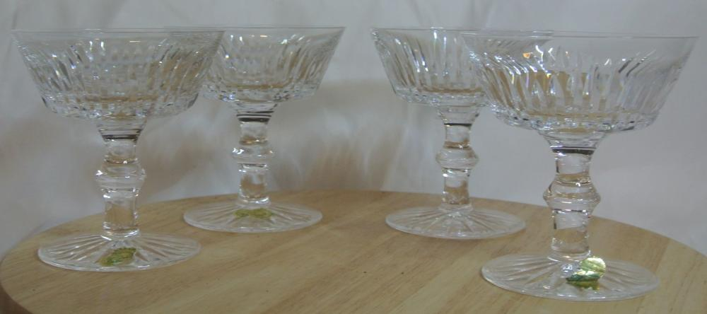 A set of 4 Waterford Crystal champagne saucers.