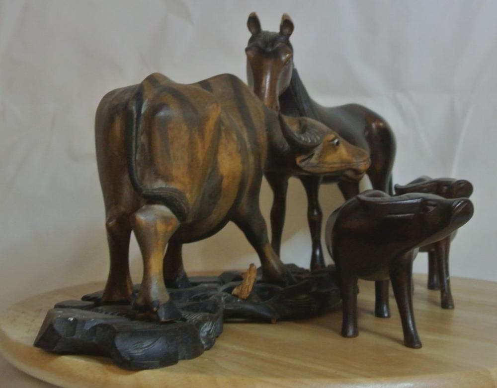 Lot 143: An assortment of various Oriental carved wooden animals