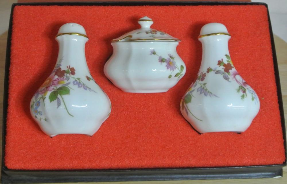 A cased condiment set, produced by Royal Crown Derby.