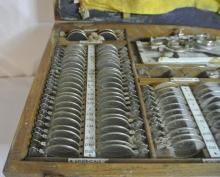 Lot 154: An antique/ vintage cased opticians eye testing kit