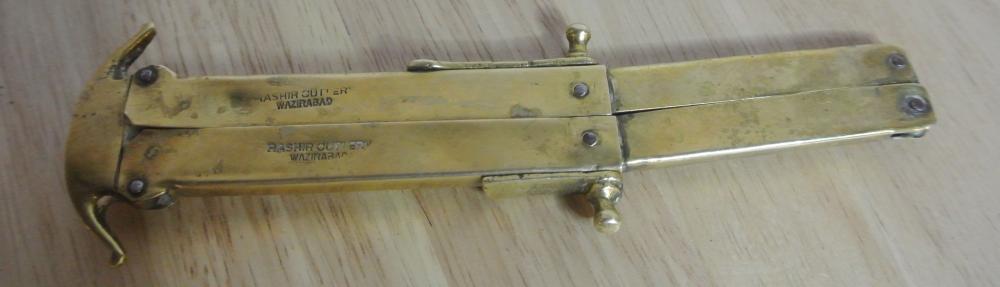 Lot 162: A WW1 era brass folding 'Paratrooper' knife
