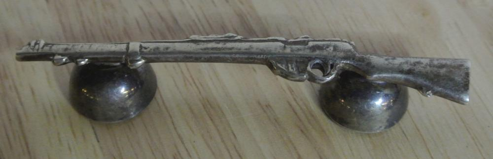 An antique/ WW1 era silver plated knife rest