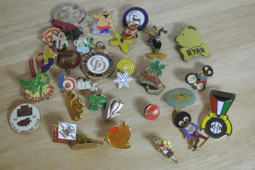 A collection of various vintage/ retro pin badges