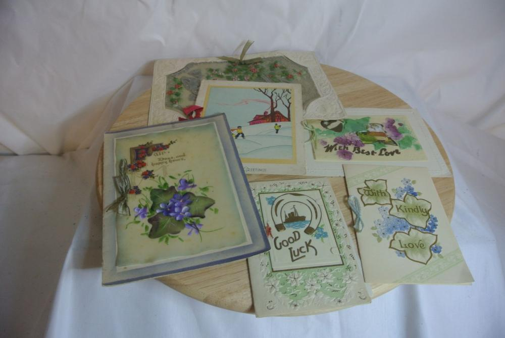 A collection of WW1 era celluloid greeting cards.
