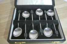 Lot 184: A cased set of 6 sterling silver coffee bean spoons.