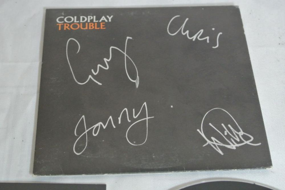 Lot 194: A signed Coldplay 'Trouble' single, signed in silver pen by the band