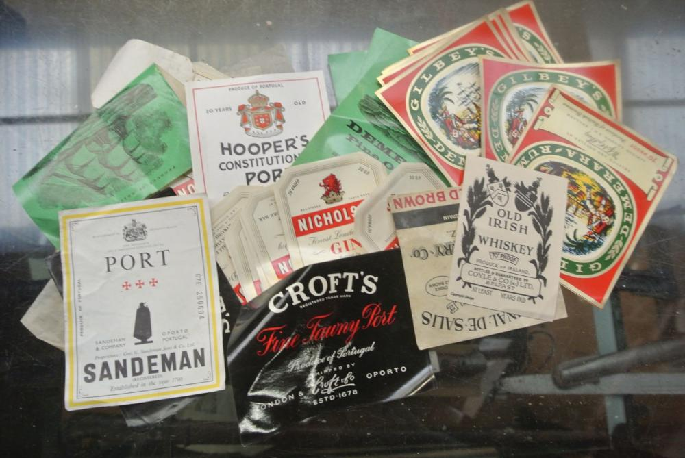 A large assortment of various unused whiskey/ spirit bottle labels.