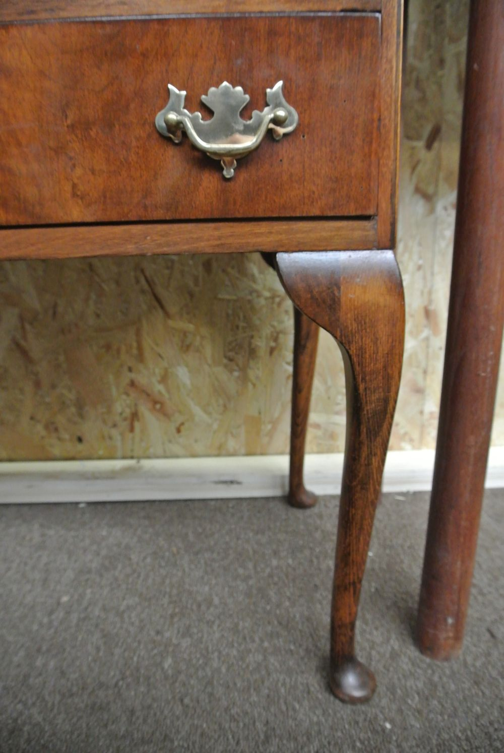 Lot 12: An antique writing bureau on cabriole legs with brass hardware.