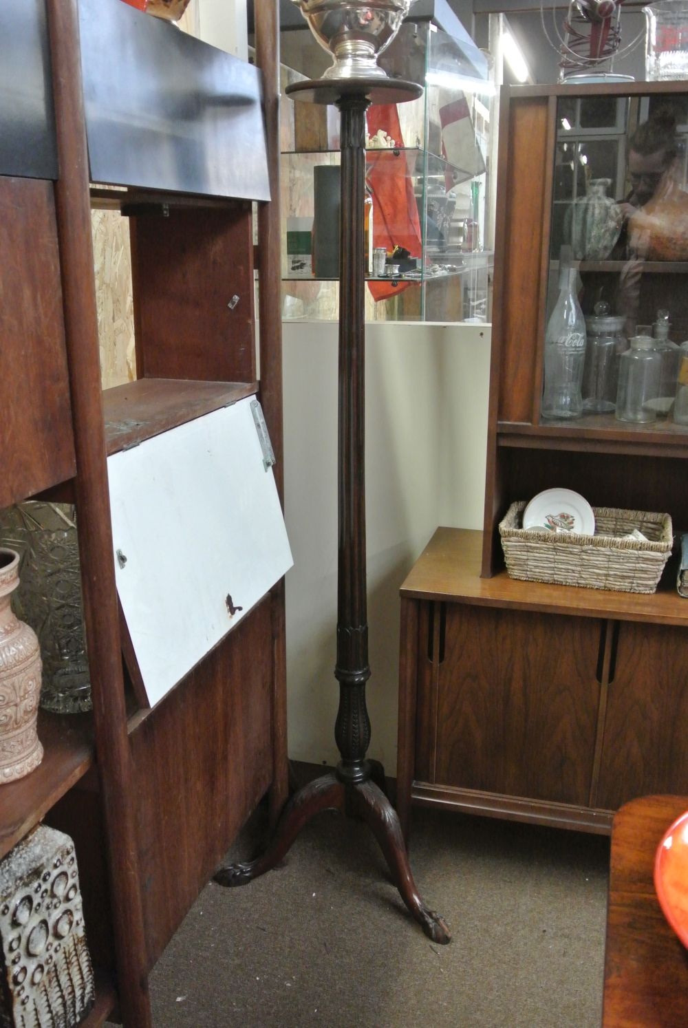 An antique Victorian carved mahogany torchere