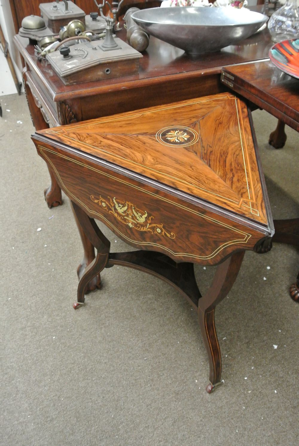 A stunning antique inlaid rosewood drop leaf occasional table