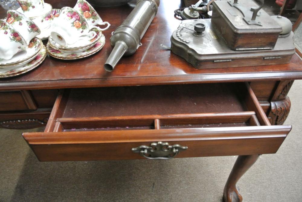 Lot 104: An antique style office desk