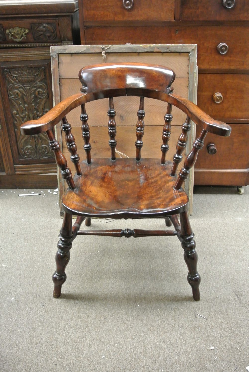 An antique Victorian smokers chair with beautiful patina.