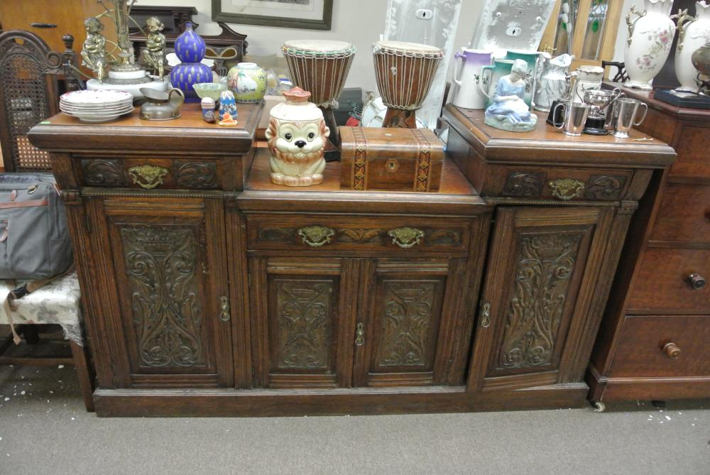An antique heavily carved Victorian sideboard