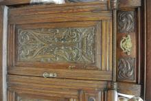 Lot 129: An antique heavily carved Victorian sideboard