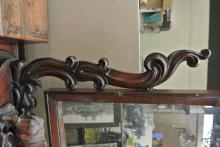 Lot 142: A large antique dressing table mirror with carved supports.
