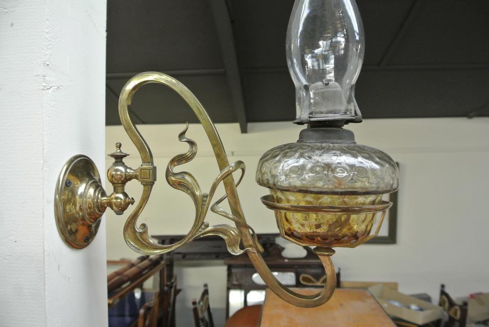 Lot 133: An antique Art Nouveau brass oil lamp bracket