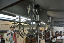 Lot 151: A large 8 branch wrought iron chandelier/ light fitting.