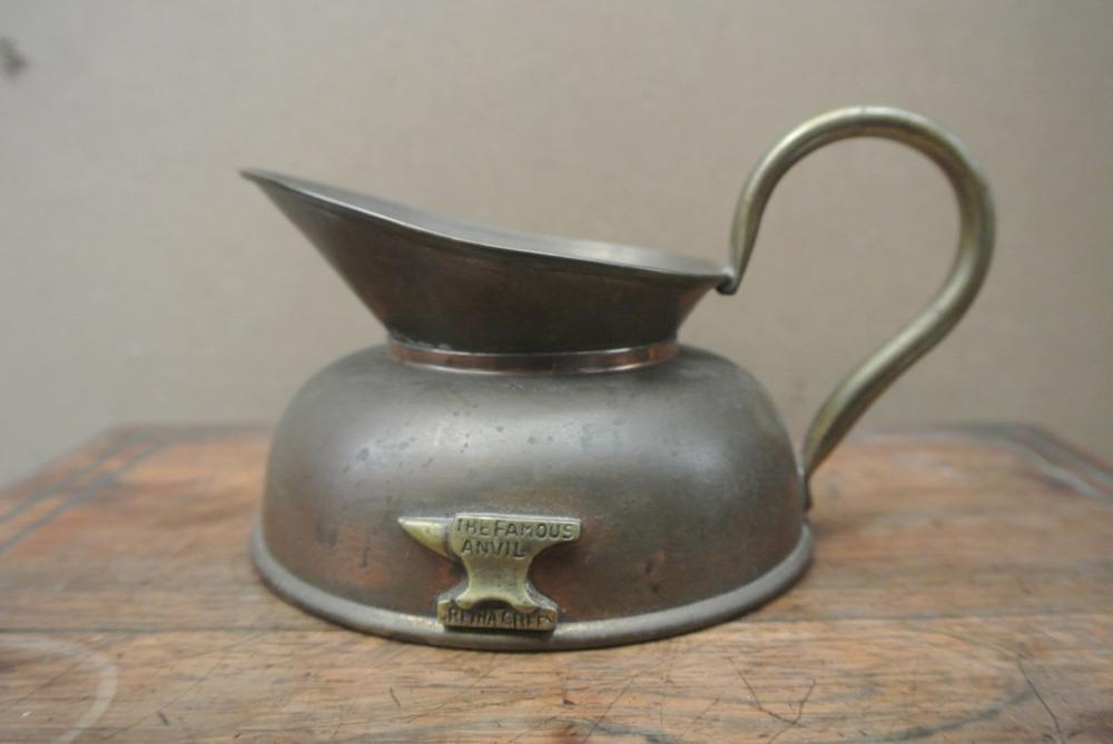 Lot 126: A vintage brass & copper jug