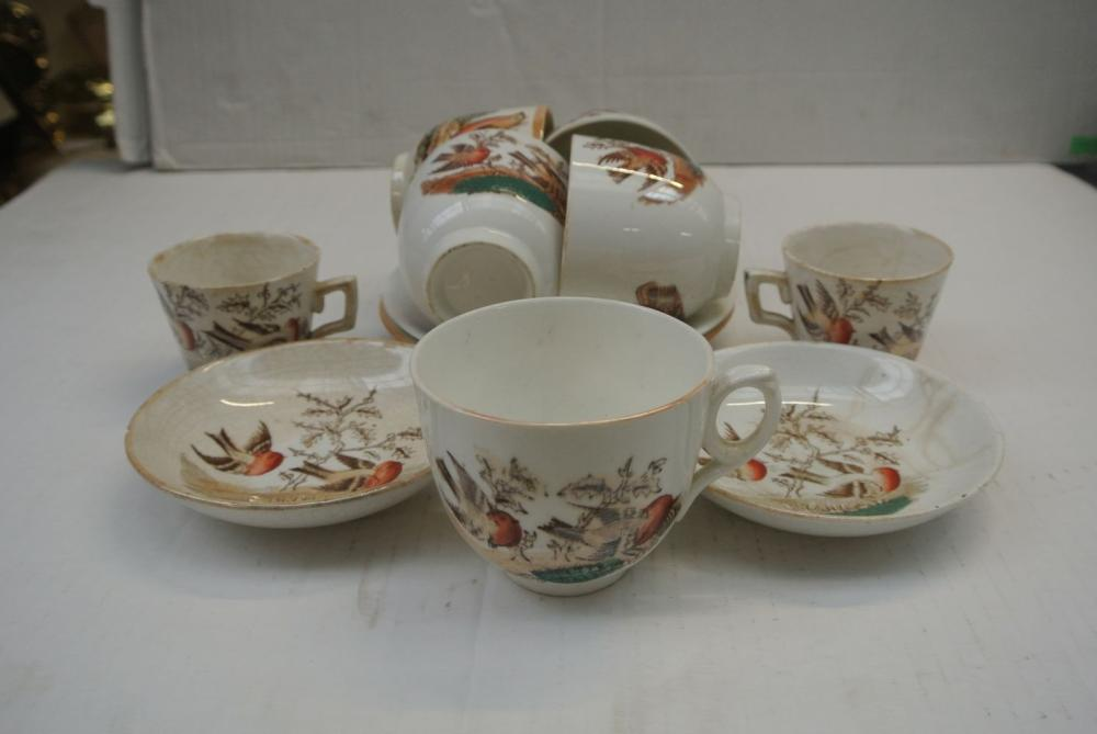 Lot 86: A collection of various antique Irish Country cups & saucers