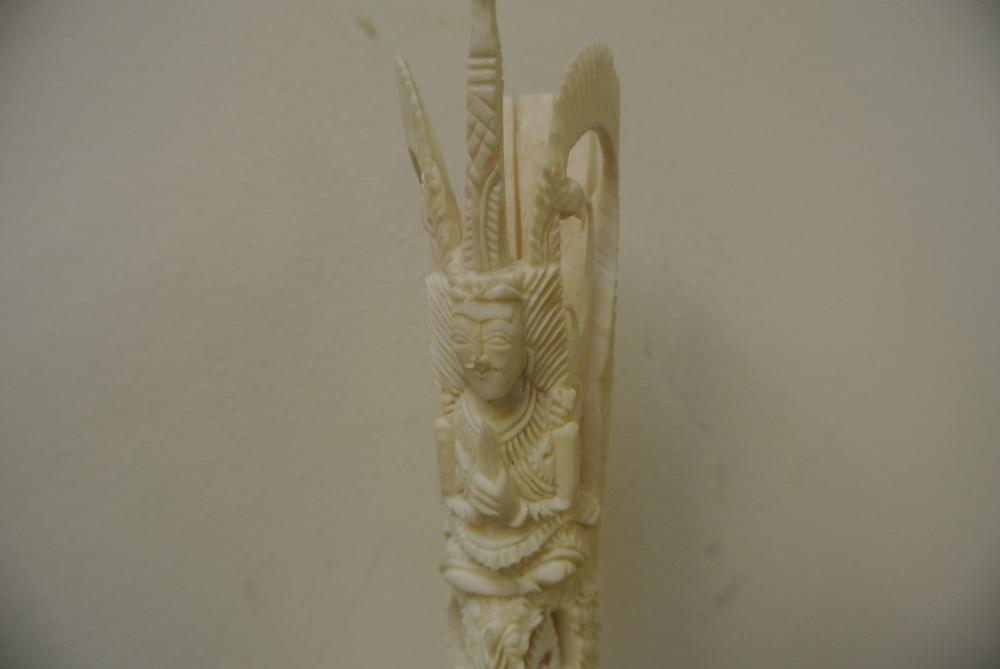 Lot 111: A finely carved Oriental/ Chinese bone piece showing a warrior.